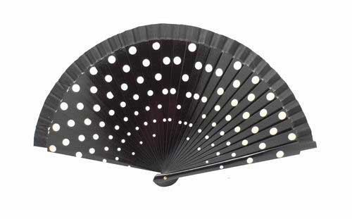 Black fan in wood painted with white polka dots on both sides